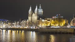 a wide angle night shot of basilica st nicholas in amsterdam, netherlands