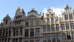 a panning shot of several of the guild houses at grand place in brussels, belgium