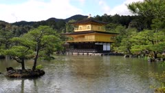 an afternoon view of kinkaku-ji, also known as golden pavilion, in the city of kyoto, japan