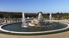 wide angle 120p slow motion clip of latona fountain in the gardens of versailles palace in paris, france