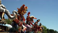 a panning shot of ogoh-ogoh statues on display at kuta beach on bali, indonesia after the nyepi parade