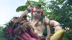 an extreme close up of an ogoh-ogoh and dragon statue for the hindu new year parade on a kuta street of bali