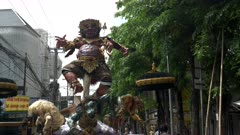 an ogoh-ogoh statue on a kuta street for the nyepi parade in bali, indonesia