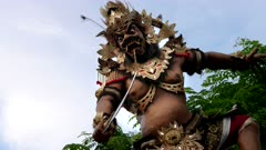 an ogoh-ogoh statue with smoke special effect at kuta on the island of bali for the hindu new year celebrations