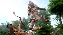 a wide shot of an ogoh-ogoh statue with smoke for nyepi parade in kuta,on the island of bali, indonesia