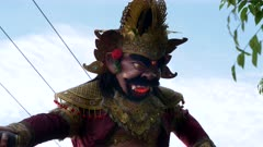 close up of an ogoh-ogoh statue, with glowing red lights, on a kuta street in bali, indonesia