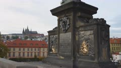 bronze plaque commenorating a famous dog on charles bridge in prague, czech republic