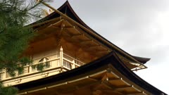 close up of the roof and eaves of kinkakuji temple in kyoto, japan