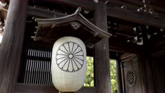 close view of a paper lantern with royal emblem at meiji jingu shrine in tokyo, japan