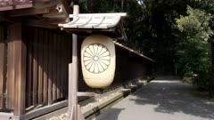 a paper lantern with royal emblem at meiji jingu shrine in tokyo, japan