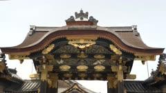 a gimbal shot walking towards the noji castle karamon gate in kyoto, japan