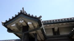 close view of roof and tile detail on a building at the hirakawa gate to the imperial palace's east garden in tokyo, japan