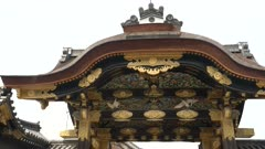 wide pan of the karamon entrance gate at nijo-jo castle in kyoto, japan