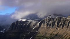 fresh snow and storm clouds on bishops cap and mt pollock at glacier national park in montana, usa