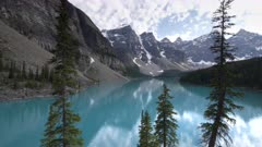 an afternoon pan of the turquoise blue moraine lake at banff national park in canada
