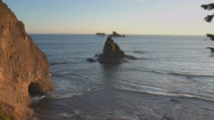 sunset shot of the hole in wall rock formation at rialto beach in the olympic national park of the us pacific northwest
