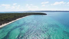 an aerial view of the beach and waters of peel island looking towards north stradbroke island in morton bay, australia
