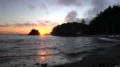 a sunset shot of waves on the shore at rialto beach in the olympic national park of the us pacific northwest