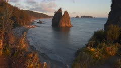 a wide angle sunset clip of split rock at rialto beach in the olympic national park of the us pacific northwest
