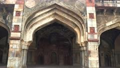 a close up gimbal shot walking towards a bara gumbad arch at lodhi gardens in new delhi, india