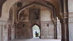 interior view of a bara gumbad window and sikh man sitting on it at lodhi gardens in delhi, india- 4K 60p