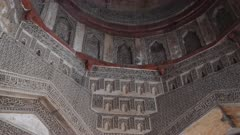 a tilt down shot of the interior of bara gumbad at lodi gardens in delhi, delhi- 4K 60p