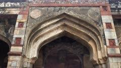 tilt up gimbal shot walking towards of the medieval monument bara gumbad at lodhi gardens in delhi, india