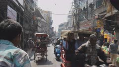 a pov shot of a rickshaw ride to the spice market at chandni chowk in old delhi, india