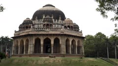 a multi axis gimbal steadicam shot walking towards tomb of muhammad shah at lodhi gardens in new delhi, india