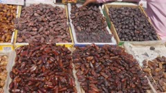 dried dates on display at the spice market at chandni chowk in old delhi, india- 4K 60p