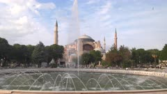 an afternoon view of hagia sophia mosque and the fountain at sultan ahmed square in istanbul, turkey