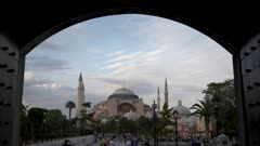 a late afternoon shot of hagia sophia framed by an archway in istanbul, turkey