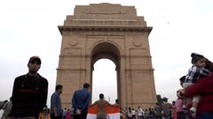 a protester with indian flag demonstrates at india gate in new delhi, india