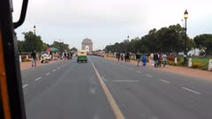 a 4K  60p pov clip riding a tuk tuk towards india gate in new delhi, india