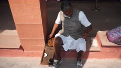 a man spins thread with a replica folding spinning wheel of the type invented and used by mahatma gandhi -4K 60p recorded at gandhi smriti in delhi, india