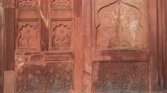 close up of ornate carved floral wall decoration on a building at red fort in delhi, india