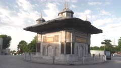a wide view of the fountain of ahmed III near the hagia sophia in istanbul, turkey