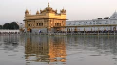 a close up of the famous golden temple and sacred pool on an afternoon in amritsar, india