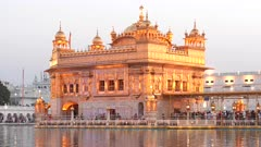 a close view of the beautiful golden temple at sunset in amritsar, india