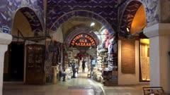 gimbal steadicam clip walking towards an illuminated sign in the grand bazaar of istanbul, turkey