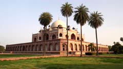a sunset zoom in clip of the unesco world heritage listed humayun's tomb in delhi, india