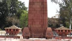 a  close tilt up shot of jallianwala bagh memorial in amritsar, india