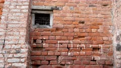 pan of bullet marks on a wall at jallianwala bagh massacre site in amritsar, india