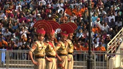 four indian soldiers face pakistan during the closing ceremony at the wagah border in amritsar, india