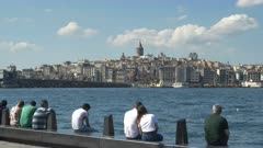 people enjoying some leisure time on the waterfront of istanbul, turkey
