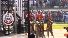 border guards carry the indian flag at the end of the closing ceremony at wagah border to pakistan in amritsar, india