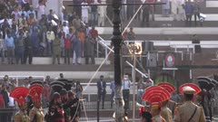 indian and pakistani border guards start lowering their national flag at wagah border in amritsar, india