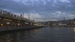restaurants on galata bridge at dusk in istanbul, turkey