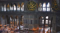 tilt up wide shot of the interior of hagia sophia mosque in istanbul, turkey