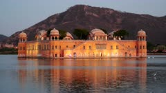 evening close up of jal mahal palace illuminated by lights in jaipur, india